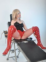 Blonde domina climbing on the examination bench