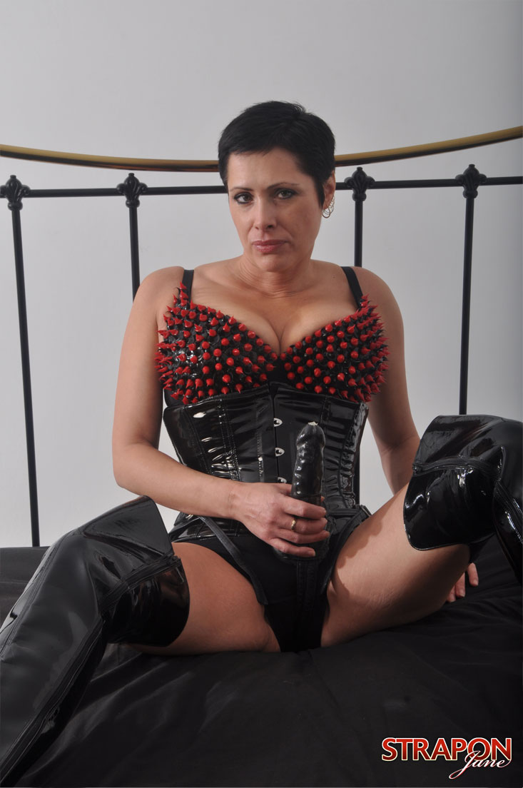 short haired femdom posing with a big strapon gallery from the