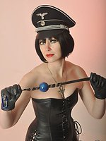 Madame Whiplash promising a proper whipping